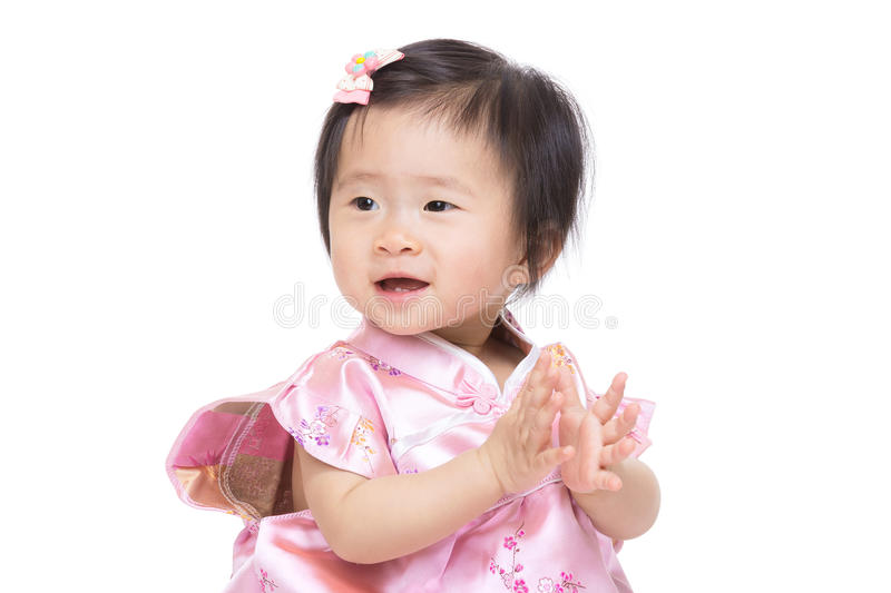 Chinese baby girl clapping hand. Isolated on white stock photos