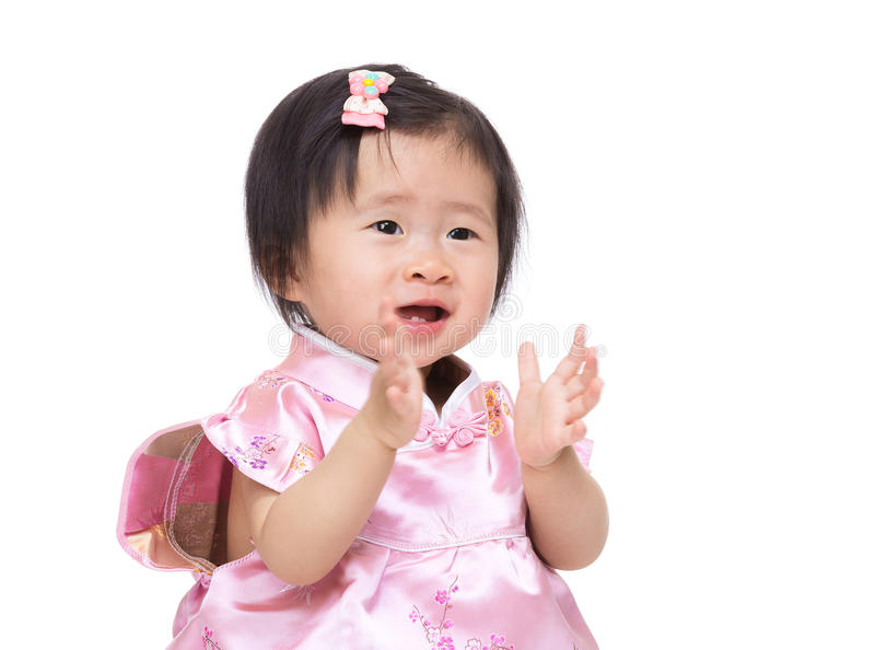 Chinese baby girl clapping hand royalty free stock photos