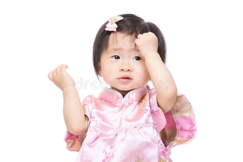 Chinese baby girl touch her head royalty free stock photo