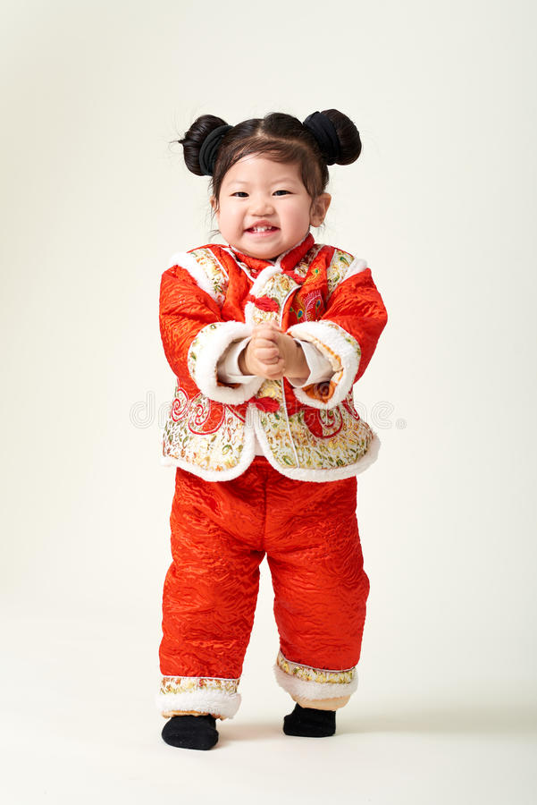 Chinese baby girl in traditional Chinese New Year outfit stock photos