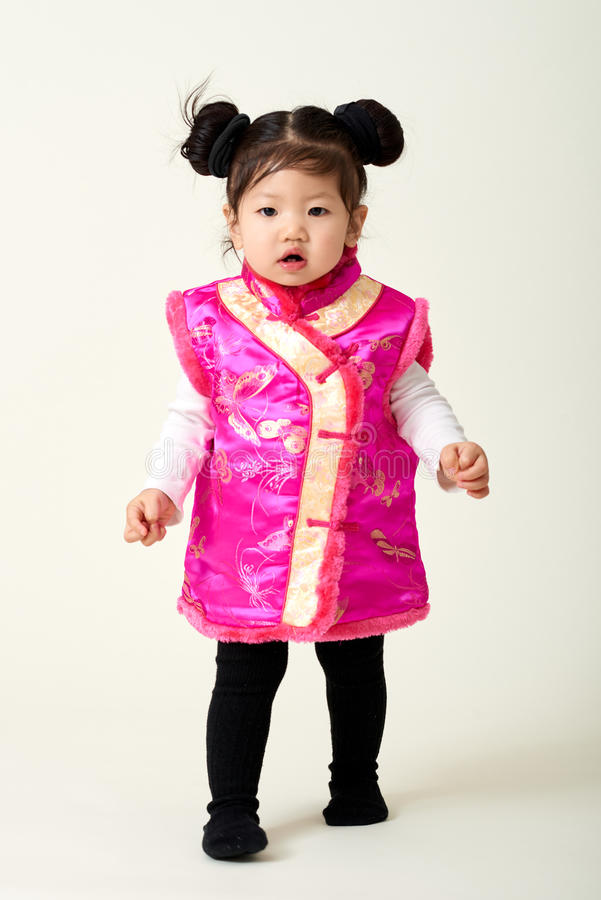 Chinese baby girl in traditional Chinese New Year outfit royalty free stock image