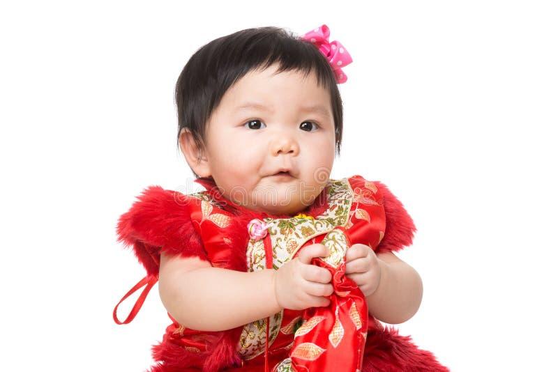 Chinese baby holding bag. Isolated on white stock photo