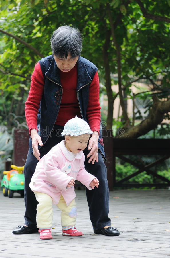 Download Chinese Baby Learn To Walk Stock Photo - Image: 18480180