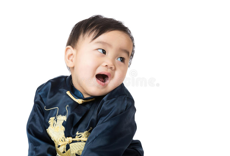 Chinese baby looking back stock photo