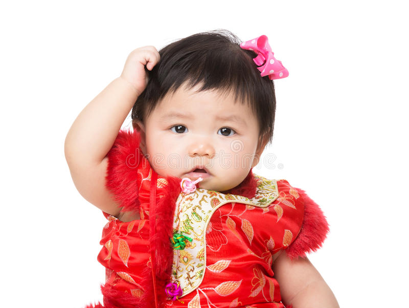 Chinese baby scratch head royalty free stock photo