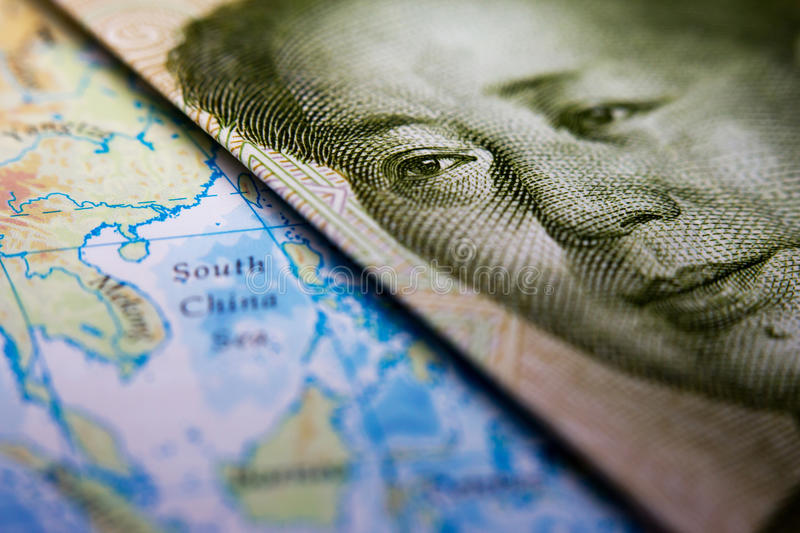 Chinese banknote and map South China Sea. Close-up of Mao Zedong on a 1 yuan Chinese banknote on top of a map showing the South China Sea stock photos
