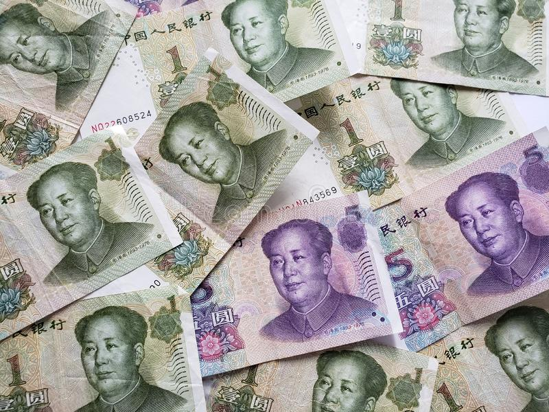 Chinese banknotes unorganized, background and texture. Commerce, exchange, trade, trading, value, buy, sell, profit, price, rate, cash, currency, paper stock images