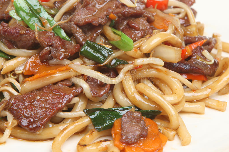 Chinese Beef with Noodles Takeaway. Chinese takeaway of beef stir-fried with noodles and beansprouts stock photos