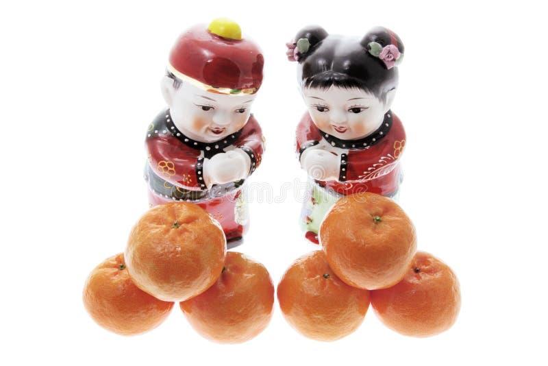 Chinese Beeldjes en Mandarins royalty-vrije stock foto's