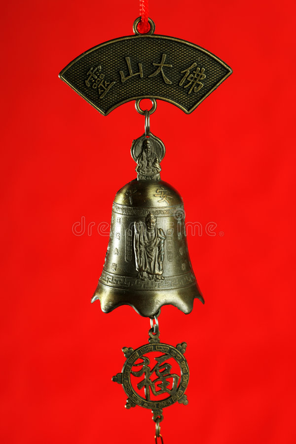 Chinese bell with buddha stock image