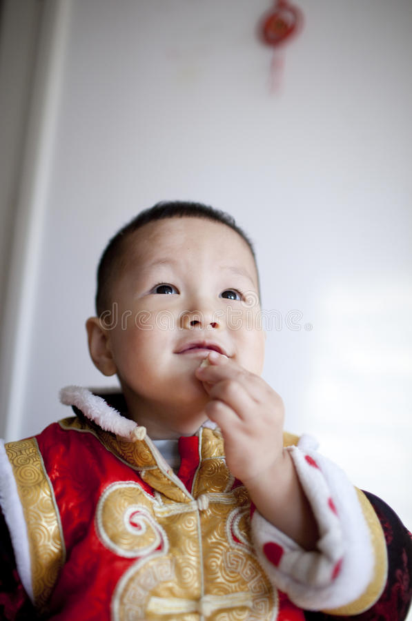 Chinese Boy Making A Wish In Chinese New Year Royalty Free Stock Images