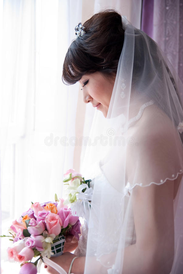 Download A Chinese Bride Looking At Bouquet Stock Photo - Image of profile, glancing: 14150764