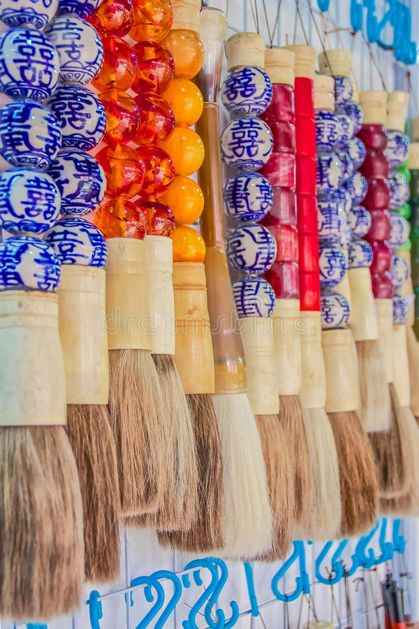Chinese brush pen. S with decorations at the market in Chinatown, Singapore royalty free stock image