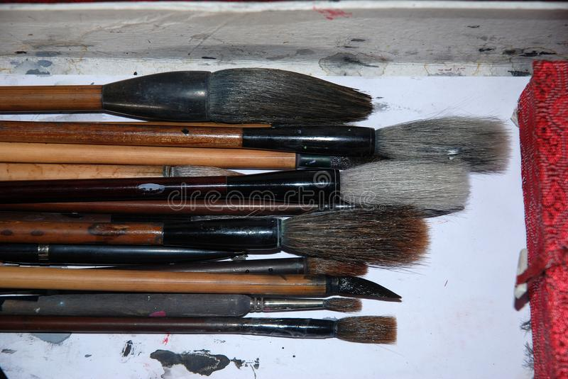 Chinese brushes for calligraphy and handwriting. Different sizes of used chinese calligraphic brushes for writing and painting stock photography