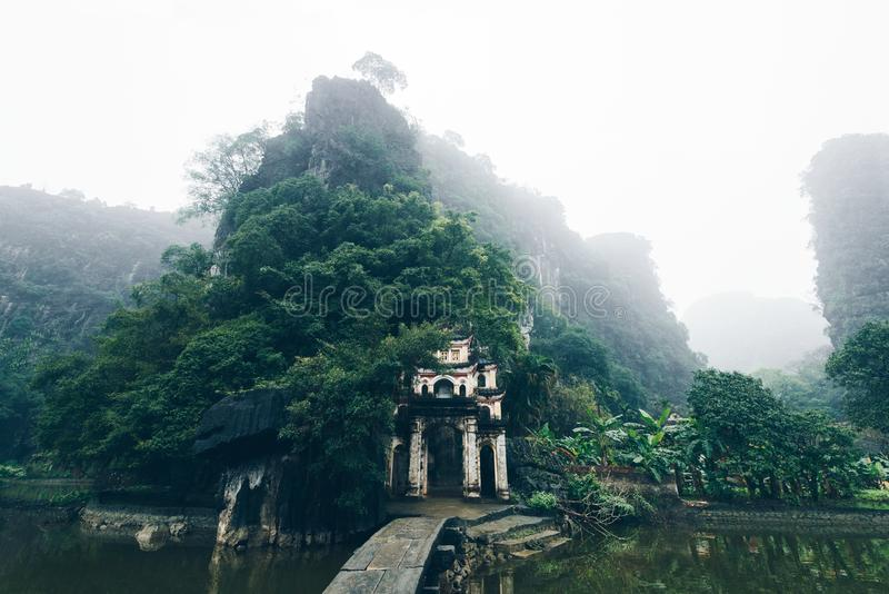 Chinese Buddhist temple in the mountains in the fog, beautiful landscape stock photo