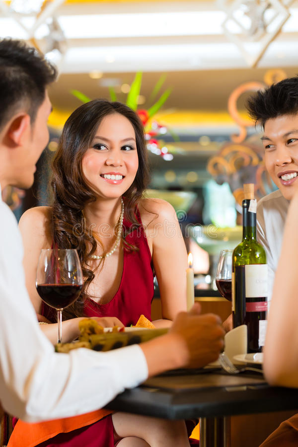 Chinese business people dining in elegant restaurant royalty free stock photo