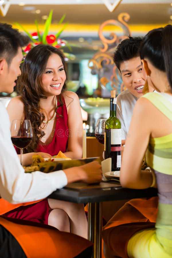 Chinese business people dining in elegant restaurant royalty free stock photos