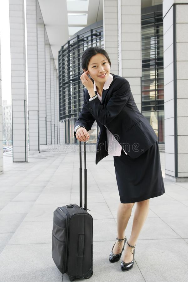 Chinese business women with suitcase stock images