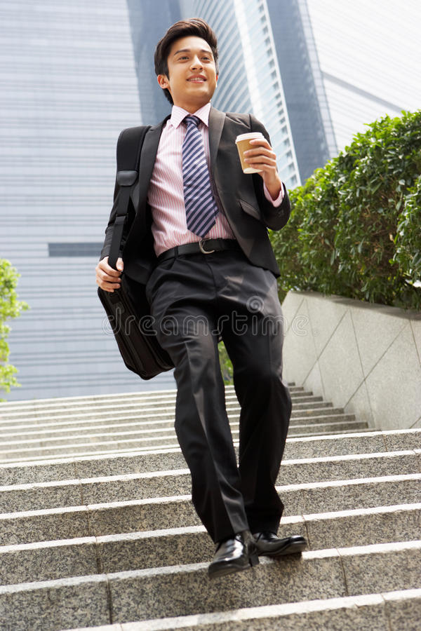 Chinese Businessman Rushing Down Steps royalty free stock images