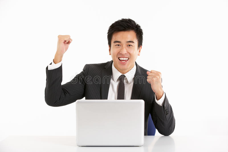 Download Chinese Businessman Working On Laptop And Celebra Stock Image - Image: 26099849