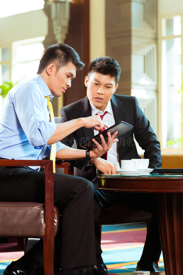 Chinese businessmen at business meeting in hotel stock photos