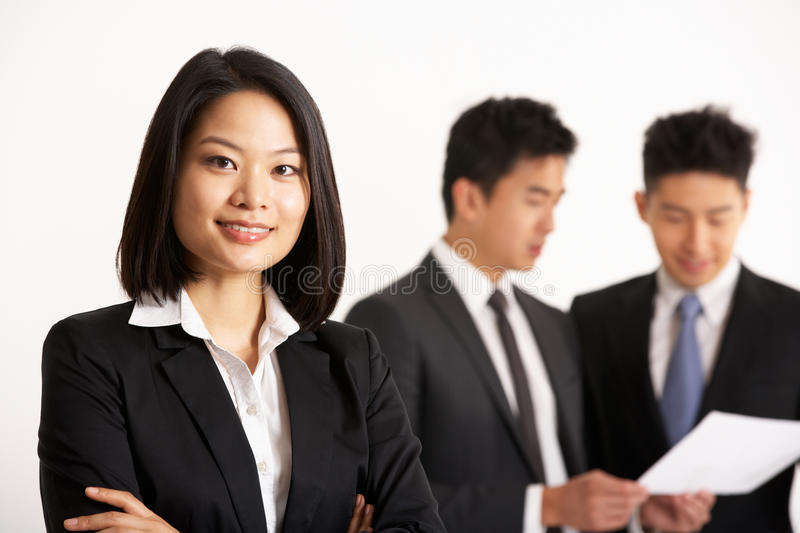 Download Chinese Businesspeople Discussing Document Stock Photo - Image: 26100126