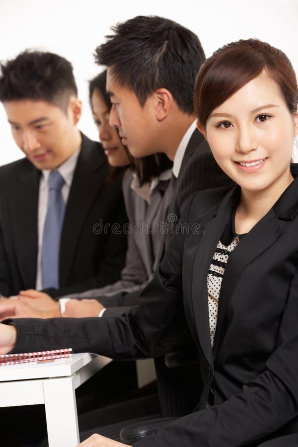 Chinese Businesspeople Having Meeting Stock Photo
