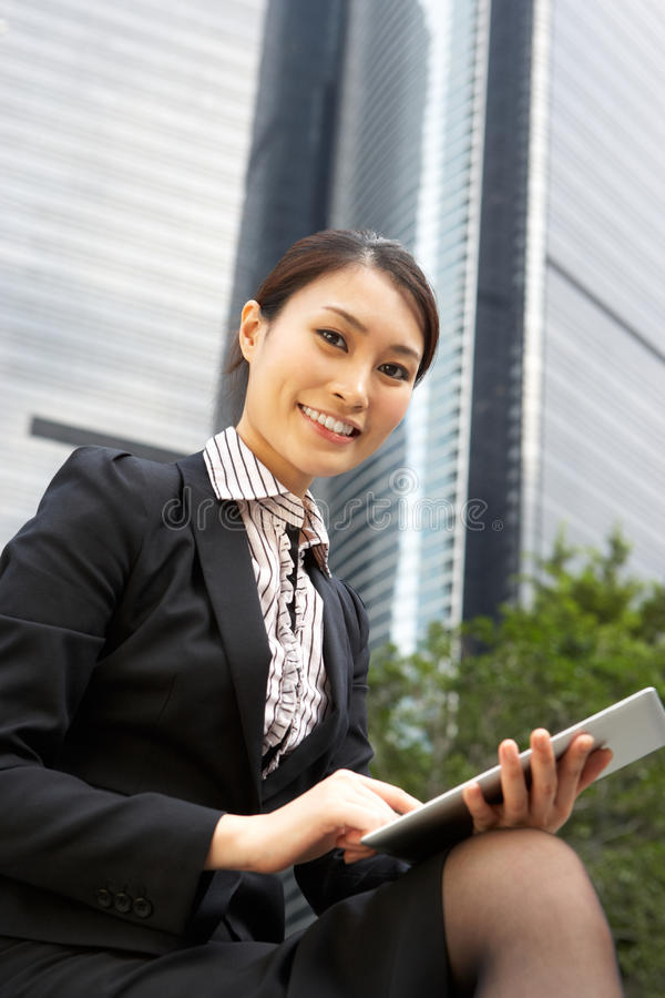 Download Chinese Businesswoman Working On Tablet Computer Stock Photo - Image: 26093676