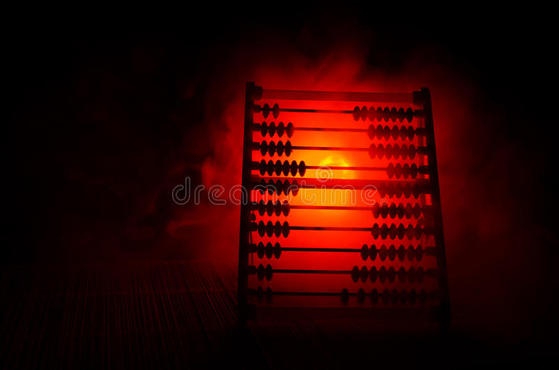 Chinese calculator with colorful beads on fire orange smoke dark background . Concept photo of business, child ,education , teachi royalty free stock photography