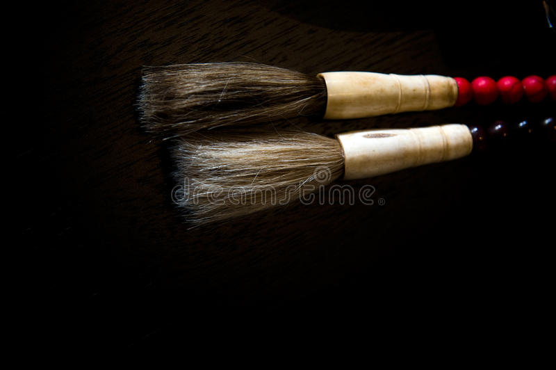 Chinese calligraphic brushes. With hair for the brush on black background stock images