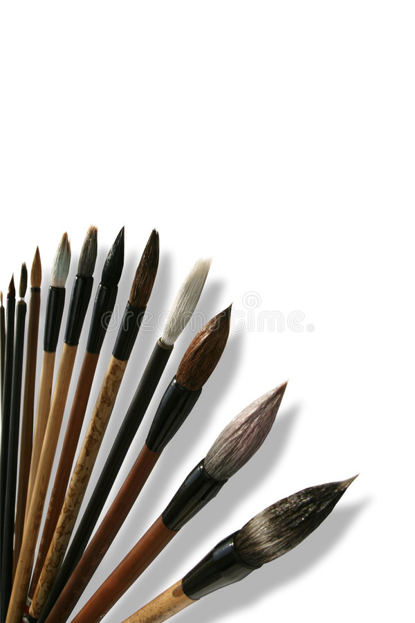 Chinese calligraphie brushes. Isolated on white stock image