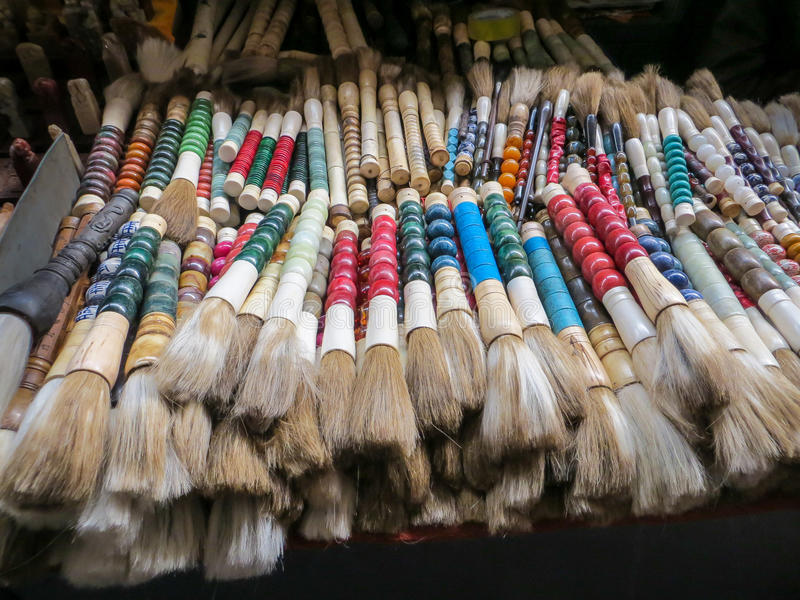 Chinese calligraphy brushes at Panjiayuan Market in Beijing, China. Selection of colorful brushes for calligraphy and Chinese painting sold at a market in stock photo