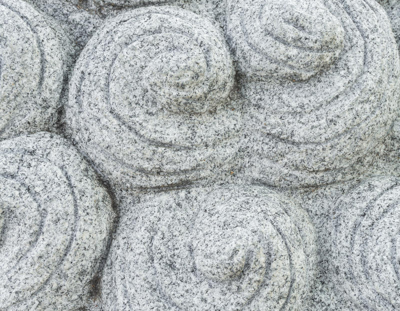 Chinese Carved Gray Stone with Round Snail Pattern royalty free stock photo