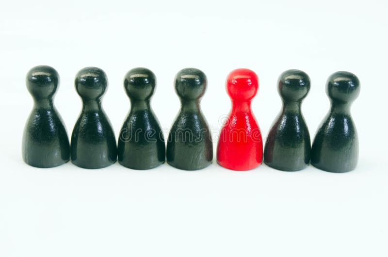 Chinese checkers. Figures with one eye-catching figure royalty free stock photography