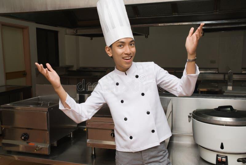 Chinese chef in restaurant kitchen stock photo