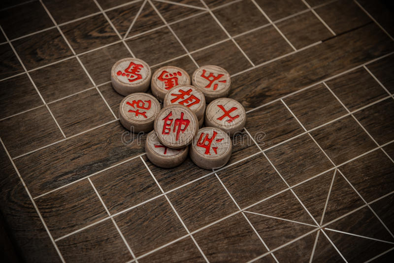 Chinese chesses on chessboard royalty free stock photo