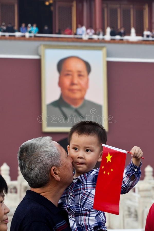 Chinese child and Chairman Mao portrait royalty free stock photo