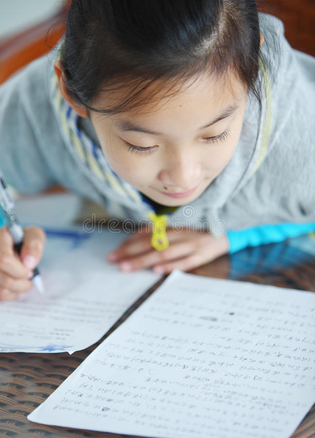 Chinese child makes homework royalty free stock photo