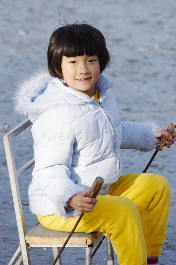 Chinese child playing on ice royalty free stock photo