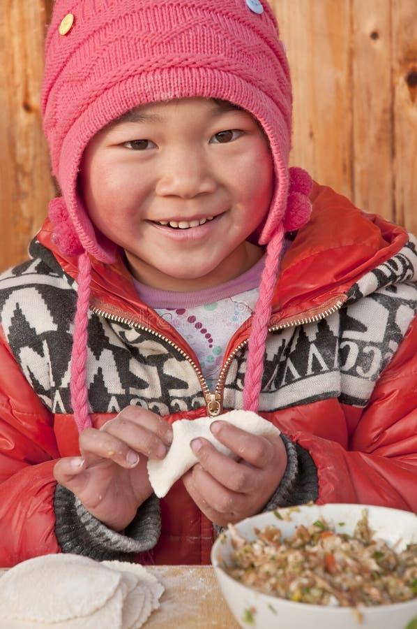 Chinese children pack dumpling stock photo