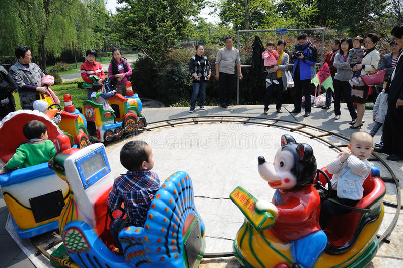 Download Chinese Children Are Playing Toy Train Editorial Stock Image - Image: 19098014