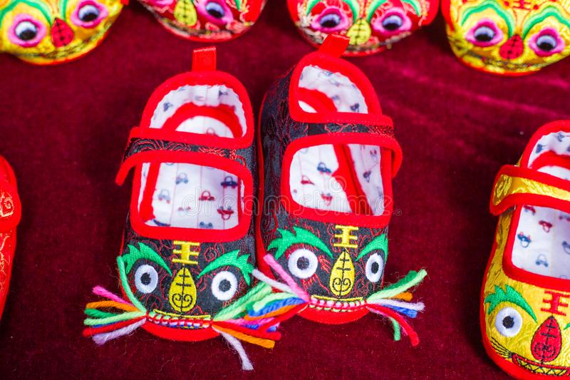 Embroidered shoes. Chinese children tiger embroidered shoes stock images
