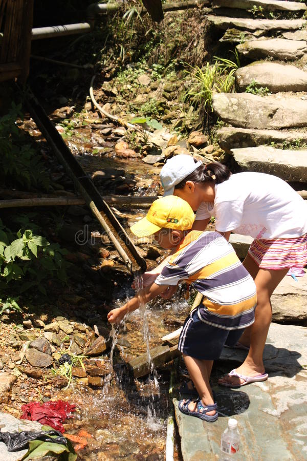 Download Chinese Children Wash Hands In Bamboo Water Drain Editorial Stock Photo - Image of longsheng, hands: 17626793