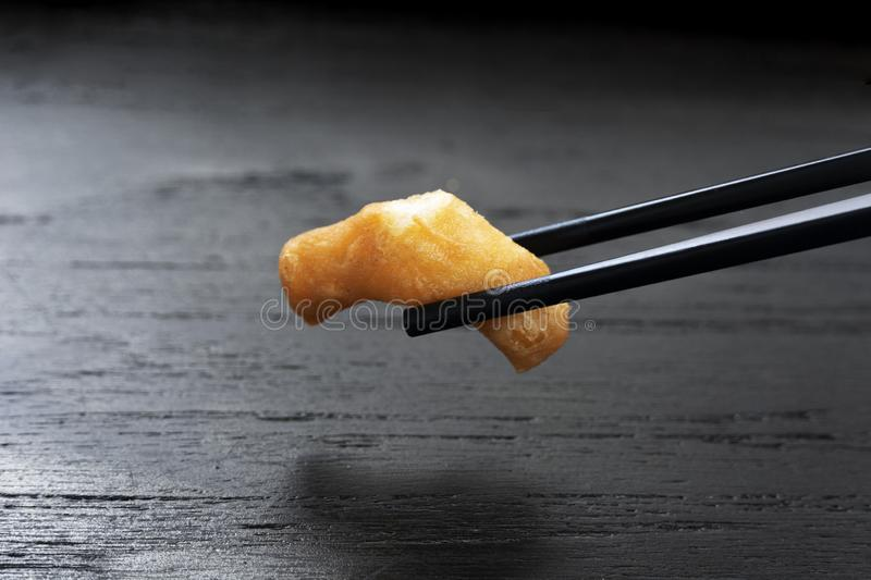 Chinese chopstick with deep-fried dough stick for morning food breakfast on black table background royalty free stock image