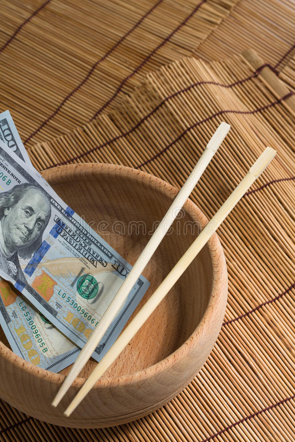 Chinese chopsticks. Dollar tip on asia background royalty free stock photos