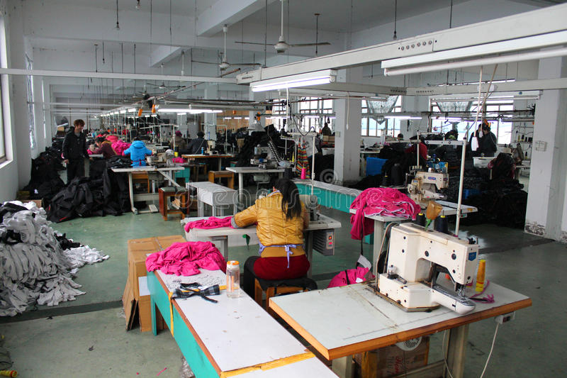 Chinese clothes factory with seamstresses royalty free stock photography