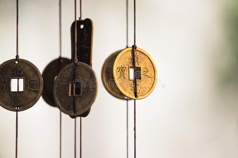 Chinese coins chime. Antique Chinese coins hanged outside the house as wind chimes for protection and good luck royalty free stock image