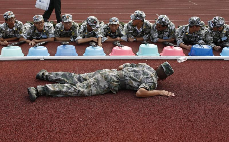 Chinese collage student military training. Freshmen from Zhejiang University practise aiming under instruction of a sergeant during the mandated military royalty free stock image