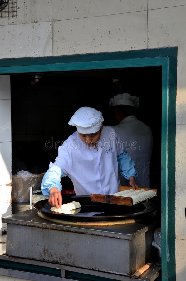 Chinese cooks food on outdoor skillet Shanghai China royalty free stock photo
