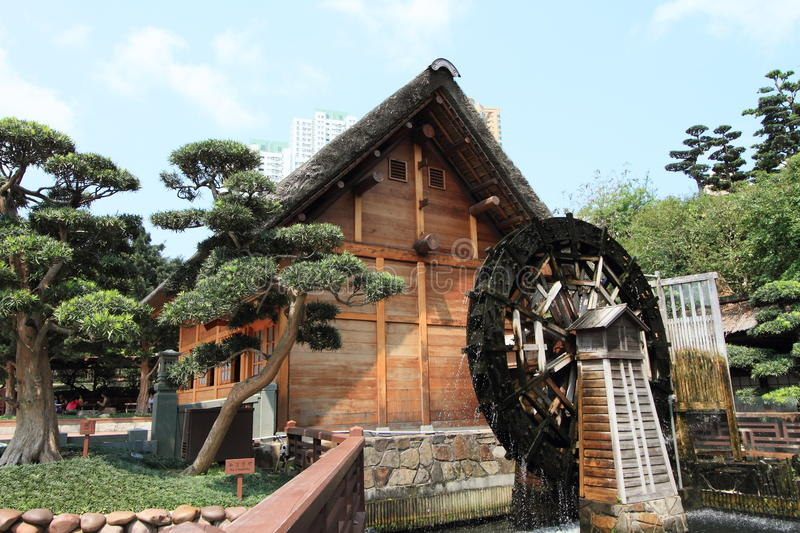 Chinese cottage and waterwheel stock images